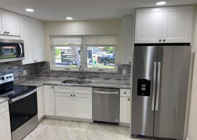 kitchen remodel with white cabinets stainless steel applicances